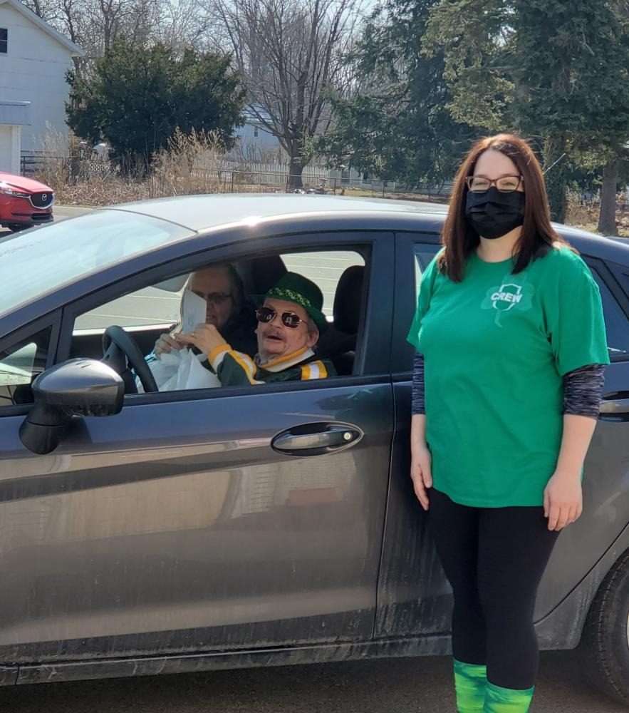 Rachael - Corry Sr Center Director - helping hand out meals at the Tri-Boro Sr Center St. Patrick's Day Grab and Go event.